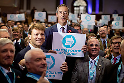 © Licensed to London News Pictures. 04/11/2019. London, UK. Brexit Party leader Nigel Farage stands in the audience whilst introducing 600 Prospective Parliamentary Candidates (PPC) at the Emmanuel Centre, who are standing for the Brexit Party ahead of the upcoming General Election. Photo credit : Tom Nicholson/LNP