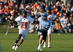 Virginia midfielder Will Barrow (23) is defended by Johns Hopkins attackman Kyle Wharton (42).  The #2 ranked Virginia Cavaliers defeated the #6 ranked Johns Hopkins Blue Jays 13-12 in overtime at the University of Virginia's Klockner Stadium in Charlottesville, VA on March 22, 2008.  The loss, in front of a record UVA crowd of 7,500, was the third consecutive overtime defeat for Hopkins, the defending national champions.