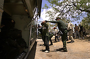 A U.S. Border Patrol agent prepares to deport a group of illegal immigrants east of Sells, Arizona, on the Tohono O'odham Nation, USA.  The area has the highest death rate of undocumented migrants crossing in to the U. S. from Mexico in the nation.