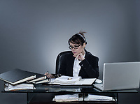 beautiful cheerful caucasian business woman working busy computing laptop computer sitting at desk on isolated background