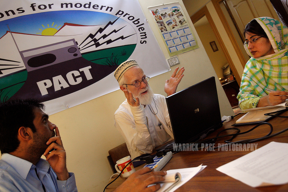 PESHAWAR, PAKISTAN - MAY 8: John Butt (C) leads colleagues in a training session at Pact Radio studios. Pact Radio is a non-governmental organisation based in Peshawar, that trains madrassa students in radio reporting, May 8, 2008, in Peshawar, Pakistan. The group also broadcasts in Pakistan's tribal belt and in war-torn Afghanistan, to provide an alternative viewpoint through without the use of commentary. Muslim extremists have used modern media to great effect in spreading their message of hate and violence on a global scale. Hundreds of illegal radio stations set up by hardline preachers in Pakistan broadcasting their violent and intolerant interpretation of Islam. (Photo by Warrick Page)