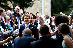 Former Prime Minister Tony Blair's Son Euan Blair gets married to  Suzanne Ashman at All Saints Church in  Wotton Underwood, United Kingdom. Saturday, 14th September 2013. Picture by Ben Stevens / i-Images<br /> <br /> Pictured are Euan Blair and  Suzanne Ashman leaving All Saints Church.