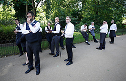© Licensed to London News Pictures. 06/06/2018. London, UK. Concerned hotel staff wait nearby as fifteen fire engines and 97 firefighters and officers have been called to a fire believed to be at the Mandarin Hotel in Kightsbridge. Photo credit: Peter Macdiarmid/LNP