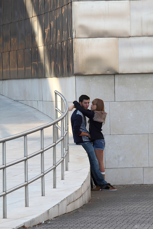 A couple hug outside the Guggenheim Museum in Bilbao