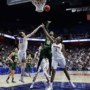 Courtney Williams, (center), USF, shoots two while defended by Breanna Stewart, (left) and Morgan Tuck  during the UConn Huskies Vs USF Bulls 2016 American Athletic Conference Championships Final. Mohegan Sun Arena, Uncasville, Connecticut, USA. 7th March 2016. Photo Tim Clayton