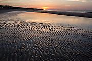 Omaha beach at the sunset