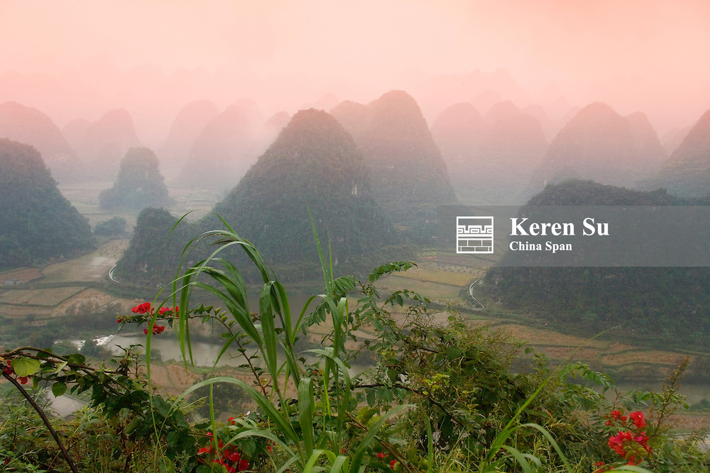 Landscape of karst hills and farmland in mist, Thousand Peaks (Wanfengling), Guizhou, China