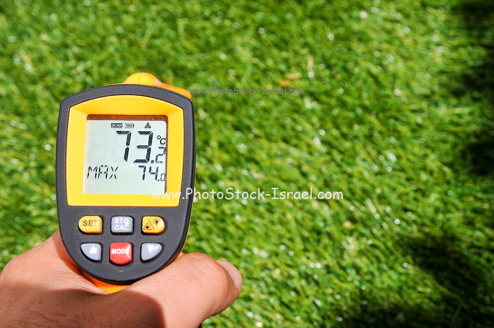 Measuring the temperature of artificial lawn in direct sun - 73 degrees Celsius