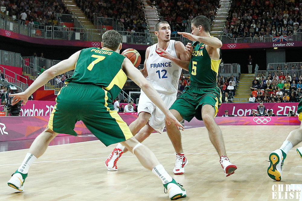 02 August 2012: France Nando De Colo drives past Lithuania Mantas Kalnietis during 82-74 Team France victory over Team Lithuania, during the men's basketball preliminary, at the Basketball Arena, in London, Great Britain.
