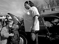 Tangela Smith watches her daughter Mooky (left) greet her half-brother Dean at the start of weekend vist at Smith's home  in Penn Hills.