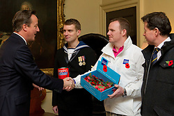 © Licensed to London News Pictures. 23/10/2014. London, UK. The British Prime Minister, David Cameron, meets former double amputee Royal Marine and Royal British Legion beneficiary Pete Dunning. Mr Dunning, and members of the British Armed Forces and British Legion, met with the Prime Minister ahead of presenting him with the first poppy to launch the 2014 British Legion Poppy Appeal. Photo credit: Matt Cetti-Roberts/LNP