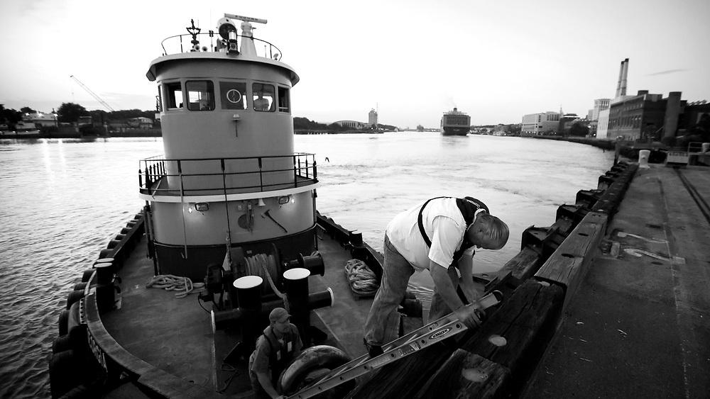 A container ship passes under the Talmadge Bridge at dawn, Saturday, June 9, 2016, at the Georgia Ports Authority Ocean Terminal near Savannah, Ga.  (GPA Photo/Stephen B. Morton)