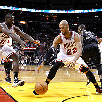 29 January 2012: Chicago Bulls forward Taj Gibson (22) eyes the loose ball next to Chicago Bulls shooting guard Ronnie Brewer (11) during the Miami Heat 97-93 victory over the Chicago Bulls at the AmericanAirlines Arena, Miami, Florida, USA.