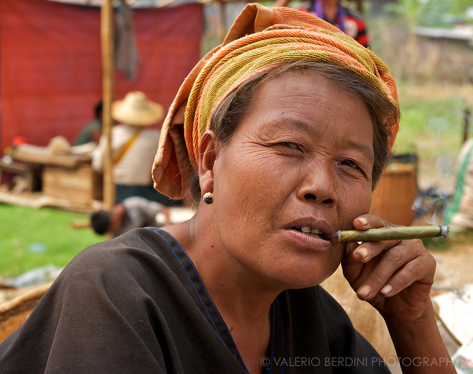 A Pa-O woman takes a cigar break. Cheroot are very popular cigars in Burma for their relatively low cost compared to cigarettes.