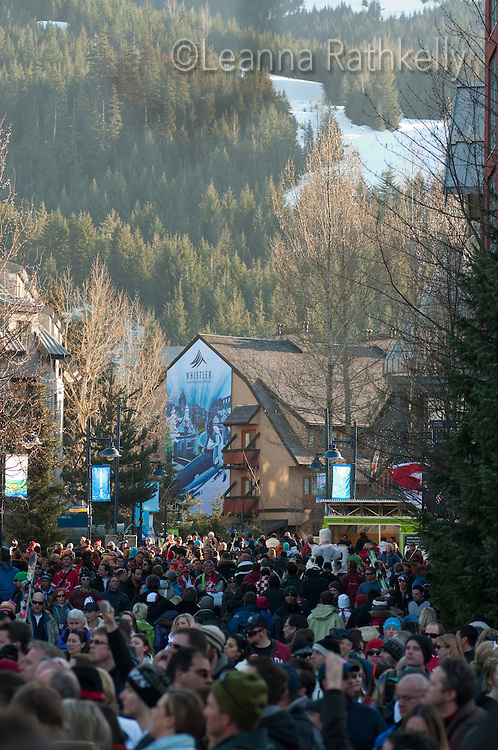 Visitors stroll through Town  Plaza on a busy day during the 2010 Olympic Winter Games in Whistler, BC Canada.