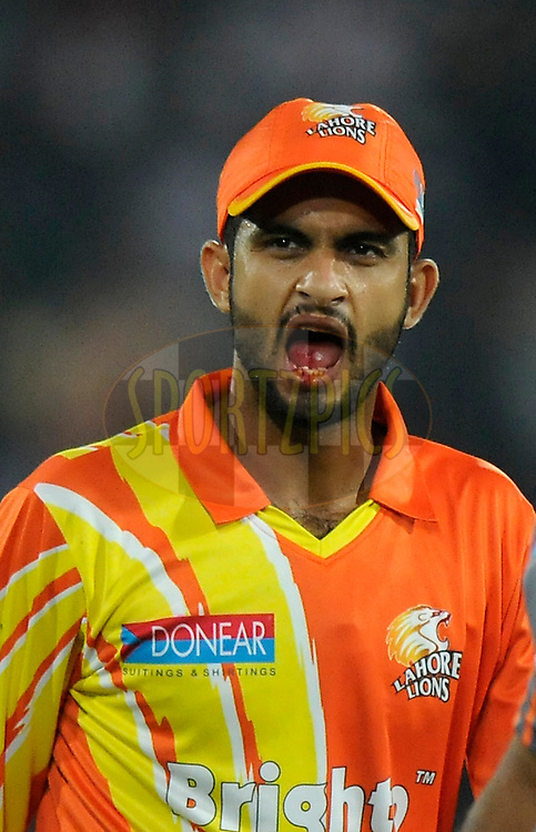 Saad Naseem of Lahore Lions walks back after getting injured during match 7 of the Oppo Champions League Twenty20 between the Kolkata Knight Riders and the Lahore Lions held at the Rajiv Gandhi Cricket Stadium, Hyderabad, India on the 21st September 2014<br /> <br /> Photo by:  Pal Pillai / Sportzpics/ CLT20<br /> <br /> <br /> Image use is subject to the terms and conditions as laid out by the BCCI/ CLT20.  The terms and conditions can be downloaded here:<br /> <br /> http://sportzpics.photoshelter.com/gallery/CLT20-Image-Terms-and-Conditions-2014/G0000IfNJn535VPU/C0000QhhKadWcjYs
