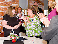 "Executive Director Linda Harvey from the Laconia Area Community Land Trust is congratulated by speaker Sandy Marshall  of Lakes Region Chamber of Commerce during the Business NH Magazines ""New Hampshire Best Business of the Decade"" award celebrated Tuesday evening at the Belknap Mill.  (Karen Bobotas/for the Laconia Daily Sun)"