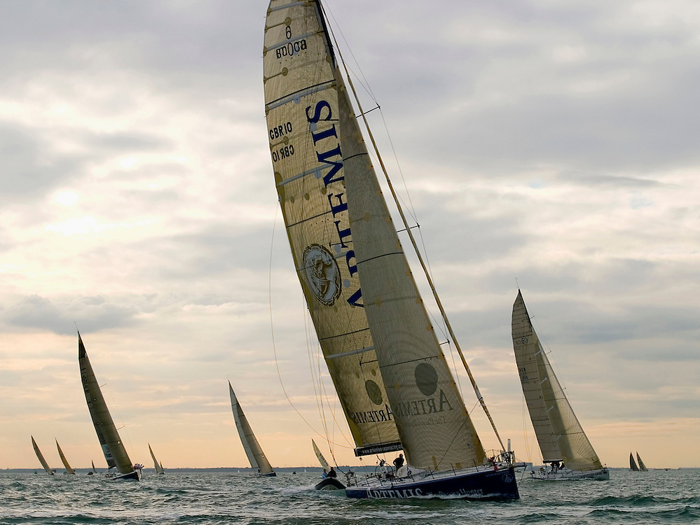 """RORC Sevenstar Round Britain and Ireland Race 2006 start, 7/8/06, Cowes UK.The Open 60 """"Artemis"""", helmed by Jonny Malbon, leads the fleet eastwards out of the Solent."""