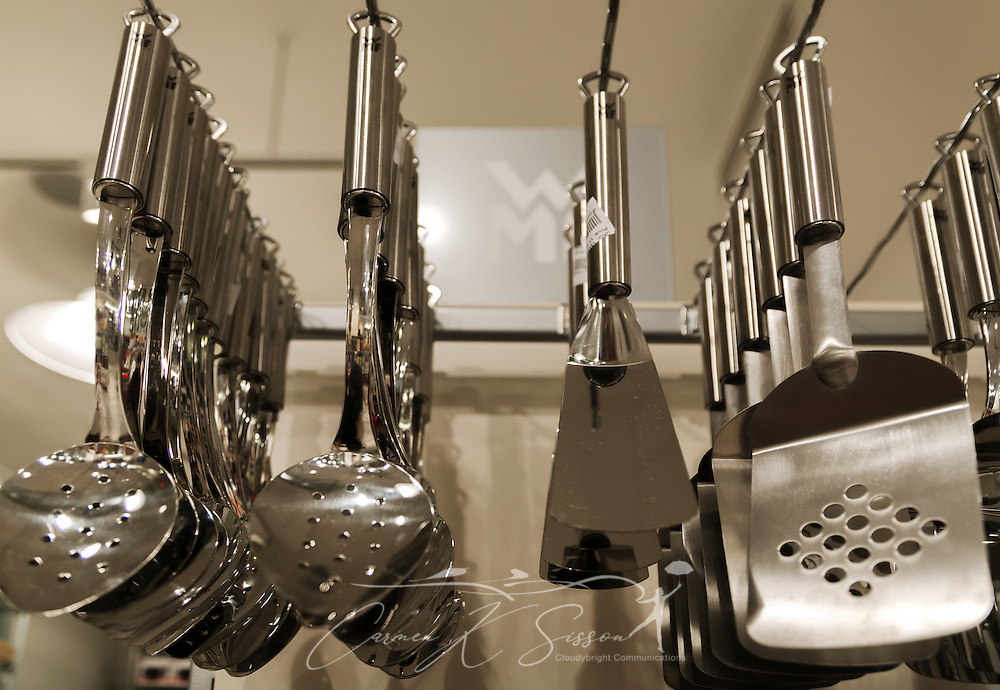 WMF utensils hang on a display rack at the Viking Range retail store.  (Photo by Carmen K. Sisson)