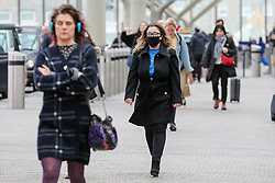 © Licensed to London News Pictures. 01/02/2020. London, UK. A woman is seen at Paddington Station wearing a fashionable face mask following the outbreak of Coronavirus in Wuhan, China. According to Twitter two people were taken to hospital from Paddington Station on the evening of Friday 31 January, amid fears that Coronavirus has speed to London. Part of the station was cordoned off following a woman sitting on a bench, while staff in face masks keep guard. Photo credit: Dinendra Haria/LNP