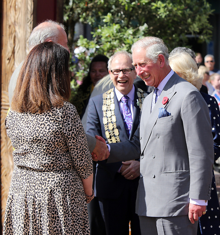 Prince Charles, Prince of Wales and Camilla, Duchess of Cornwall is welcomed by Auckland Mayor Len Brown, centre, prior to greeting fans during a walk around Aotea Square, Auckland, New Zealand, Sunday, November 08, 2015. Credit:SNPA /  Michael Bradley, AFP  *POOL**