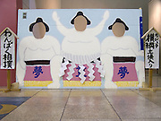 a take my picture board with traditional sumo wrestlers painted on it