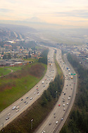 Aerial view of Interstate 5 by Boeing field looking south with Mount Rainier on the horizon in the haze of smog