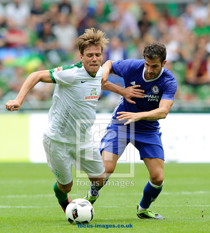 Clemens Fritz of SV Werder Bremen and Cesc<br /> Fabregas of Chelsea during the pre season friendly match at Weserstadion, Bremen, Germany.<br /> Picture by EXPA Pictures/Focus Images Ltd 07814482222<br /> 07/08/2016<br /> *** UK &amp; IRELAND ONLY ***<br /> EXPA-EIB-160807-0297.jpg