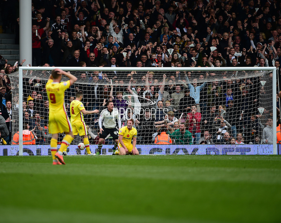 Fulham Forward Ross McCormack (44) scores first goal during the Sky Bet Championship match between Fulham and Milton Keynes Dons at Craven Cottage, London, England on 2 April 2016. Photo by Jon Bromley.