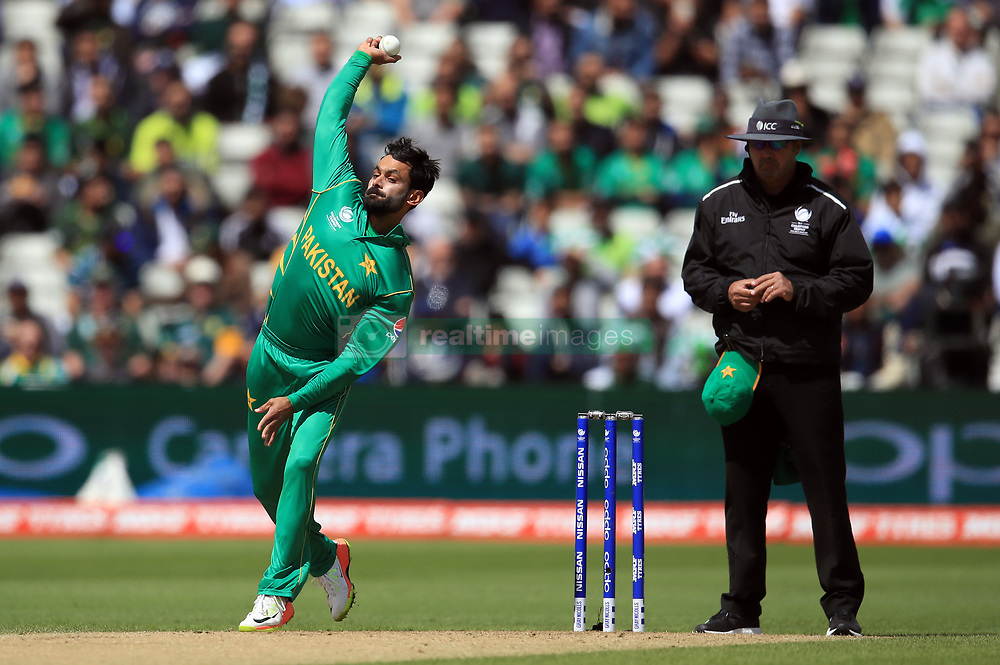 Pakistan's Mohammad Hafeez in bowling action during the ICC Champions Trophy, Group B match at Edgbaston, Birmingham.