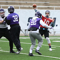 SALEM, VA - DECEMBER 14: University of Mount Union quarterback Luke Poorman throws during Stagg Bowl practice at Salem Stadium on December 14, 2017 in Salem,VA. (Photo by Steve Frommell, d3photography.com)