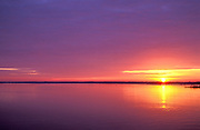 Sunrise over a calm Winyah Bay