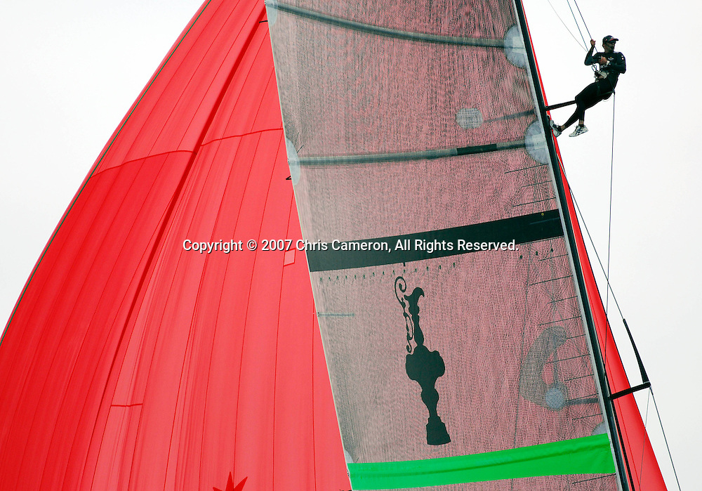 Emirates Team New Zealand traveller Adam Beashal looks for signs of wind from the mast of NZL92 in the last leg of race four of the 32nd America`s Cup against Alinghi SUi100. 27/6/2007