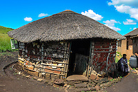 Visiting a small Zulu village near Hluhluwe in the KwaZulu-Natal province, South Africa. An old lady sitting outside the kitchen.