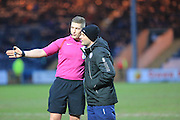 Referee Mr Jones stops play to get get Rochdale ground staff to remove a dead rat from the pitch during the EFL Sky Bet League 1 match between Rochdale and Oxford United at Spotland, Rochdale, England on 21 January 2017. Photo by Daniel Youngs.