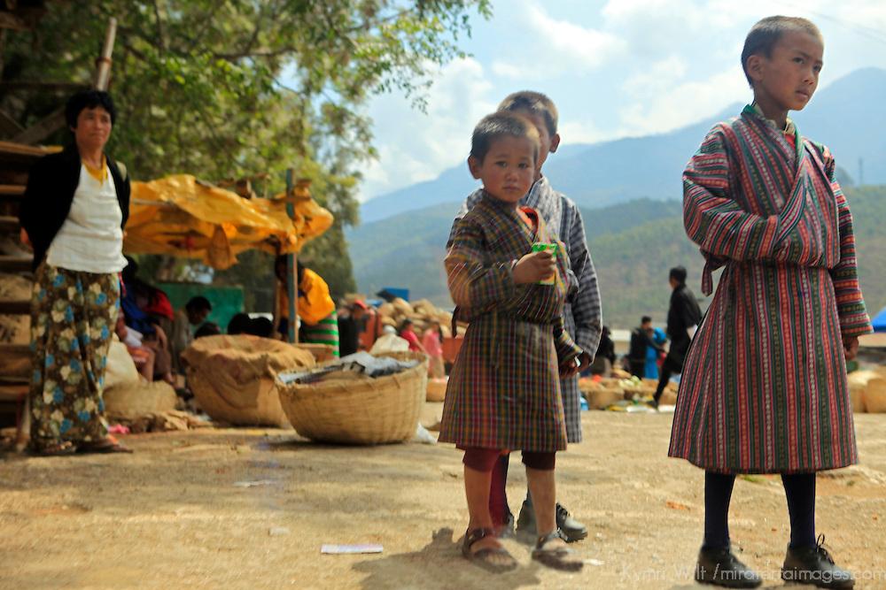 Asia, Bhutan, Wangdue. Three small Bhutanese boys at the market of Wangdue.
