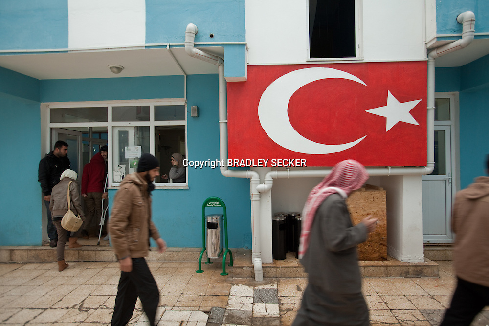 The entrance to Dar Istishfah post care centre in Reyhanli, Turkey. The centre has around 80 patients, mostly civilians, and is 500 meters from the Syrian border fence. 7/12/2012