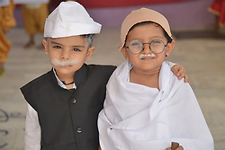 October 1, 2018 - Ajmer, Rajasthan, India - Children dressed as Mahatma Gandhi during Gandhi Jayanti in India. Gandhi Jayanti is a national festival celebrated in India to mark the occasion of the birthday of Mohandas Karamchand Gandhi, the ''Father of the Nation''. It is one of the three national holidays of the country  (Credit Image: © Shaukat Ahmed/Pacific Press via ZUMA Wire)