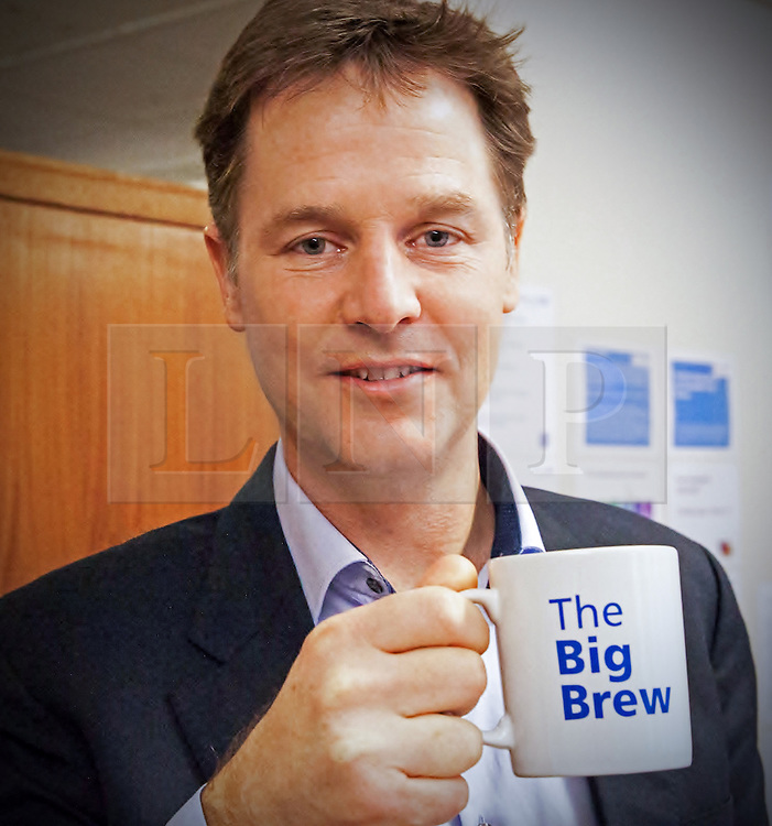 """© Licensed to London News Pictures . 19/01/2015 . Liverpool , UK . Deputy Prime Minister Nick Clegg . Celebrities pose with """" Big Brew """" mugs in support of mental health awareness as today (19th January 2015) marks """" Blue Monday """" , the day regarded by many as the most depressing in the year . Campaigners are urging the public to show support by tweeting sefies with their favourite brew and the hashtag """" #brewfie """" . In London , Deputy Prime Minister Nick Clegg , is announcing his campaign to improve mental health awareness , reduce stigma and promote a """" zero ambition """" target for suicide . Photo credit : Joel Goodman/LNP"""
