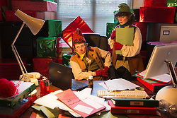 """© Licensed to London News Pictures. 19/11/2013. London, England. Picture: Michael Keane as Martin the Head of Elves and Emma MacLennan as Carol, the Elf Assistant. """"Once Upon A Christmas""""  is a promenade show from the Look Left Look Right theatre company set around Covent Garden's shops, bars and restaurants with the characters on a mission to save Christmas. Photo credit: Bettina Strenske/LNP"""