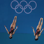 Chinese divers Ruoling Chen and Hao Wang practice their Synchronised 10m platform diving at the Aquatic Centre at Olympic Park, Stratford during the London 2012 Olympic games preparation at the London Olympics. London, UK. 24th July 2012. Photo Tim Clayton