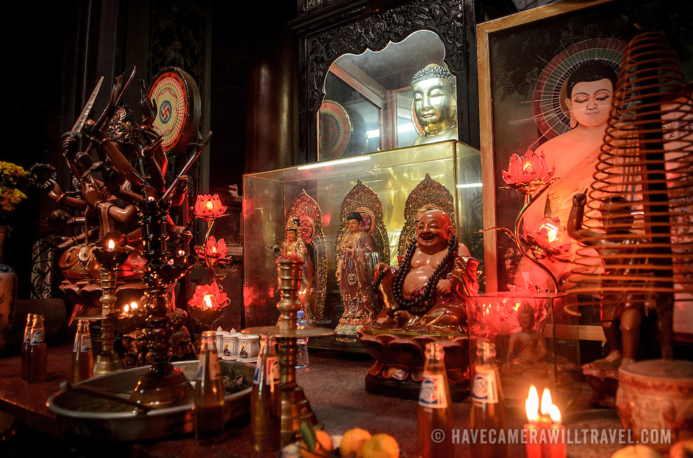 A shrine with several statues and offerings at the Jade Emperor Pagoda in the Da Kao district of Ho Chi Minh City, Vietnam. The Chinese temple was built in 1909 and contains elements of both Buddhist and Taoist religions.