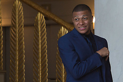 France's national Kylian Mbappe leaves after receiving the Legion of Honour during a ceremony to award French 2018 football World Cup winners, on June 4, 2019, at the Elysee Palace in Paris. Photo by Raphael Lafargue/ABACAPRESS.COM