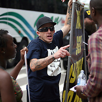 A Bible Believers member argues with a couple while protesting during the Republican National Convention in Tampa, Fla. on Wednesday, August 29, 2012. (AP Photo/Alex Menendez)