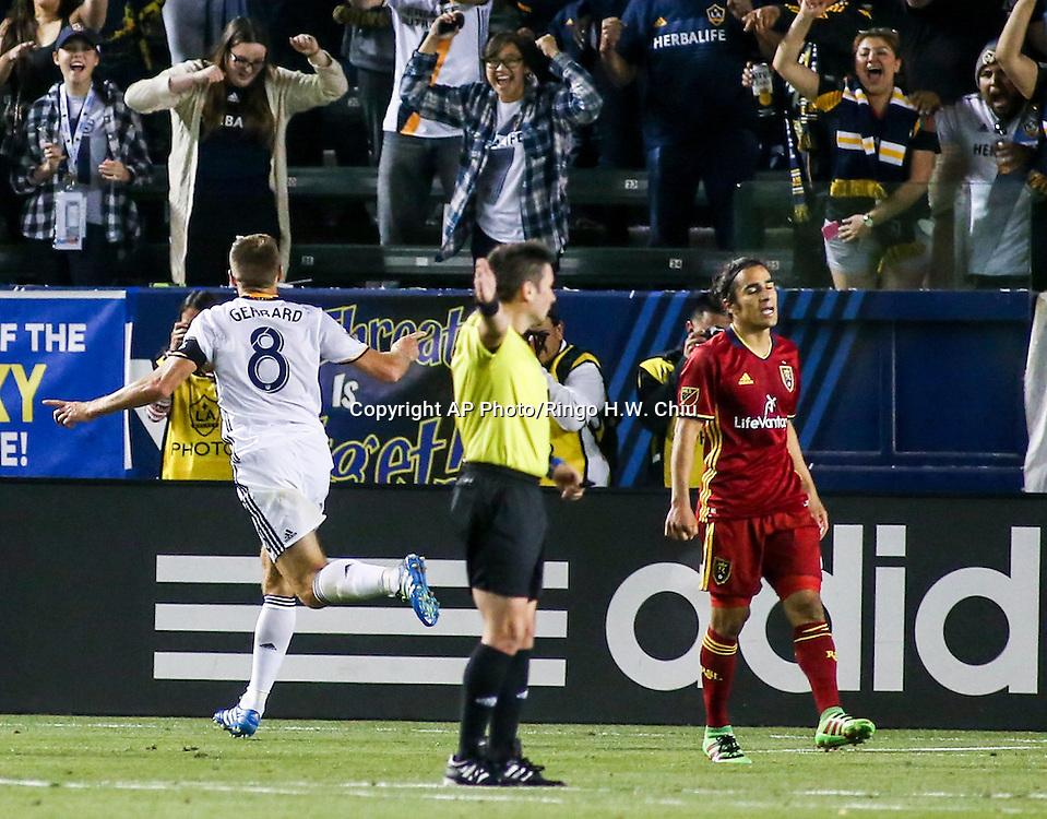 Los Angeles Galaxy midfielder Steven Gerrard, left, celebrates his gaol in the second half of an MLS soccer game in Carson, Calif., Saturday, April 23, 2016. The Galaxy won 5-2. (AP Photo/Ringo H.W. Chiu)