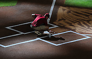 Jun. 18 2011; Phoenix, AZ, USA; Arizona Diamondbacks ground crew cleans home plate prior to the first pitch at Chase Field. The Diamondbacks host the Chicago White Sox.  Mandatory Credit: Jennifer Stewart-US PRESSWIRE.
