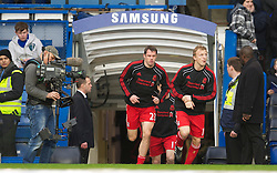 LONDON, ENGLAND - Sunday, February 6, 2011: Liverpool's Jamie Carragher, returning from injury, runs out for the warm-up before the Premiership match against Chelsea at Stamford Bridge. (Photo by David Rawcliffe/Propaganda)