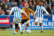 Reece Brown of Huddersfield Town  goes past Jaden Brown of Huddersfield Town  during the EFL Sky Bet Championship match between Huddersfield Town and Hull City at the John Smiths Stadium, Huddersfield, England on 5 October 2019.
