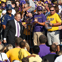 September 10, 2011; Baton Rouge, LA, USA;  LSU Tigers head coach Les Miles walks down Victory Hill prior to kickoff of a game against the Northwestern State Demons at Tiger Stadium.  LSU defeated Northwestern State 49-3. Mandatory Credit: Derick E. Hingle-US PRESSWIRE