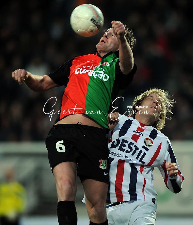 21-03-09 Voetbal:NEC Nijmegen:Willem II:Nijmegen<br /> Patrick Pothuizen wint het luchtduel van Frank Demouge<br /> Foto: Geert van Erven